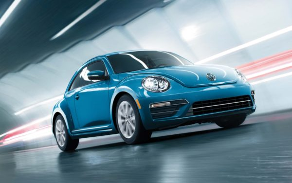 Blue 2017 VW Beetle driving through a tunnel
