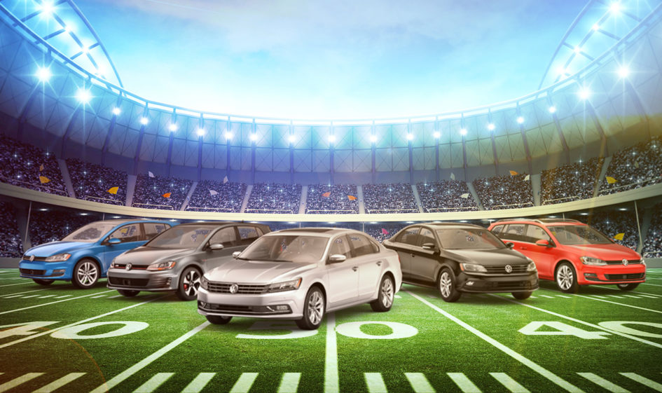 A custom-made image of five popular VW models on a football field inside of a stadium