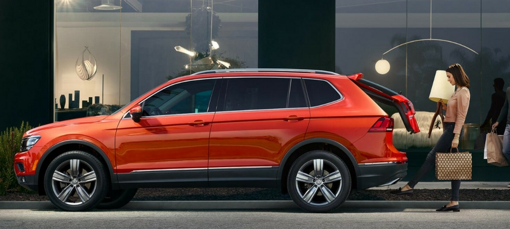A side view of a red 2018 Volkswagen Tiguan