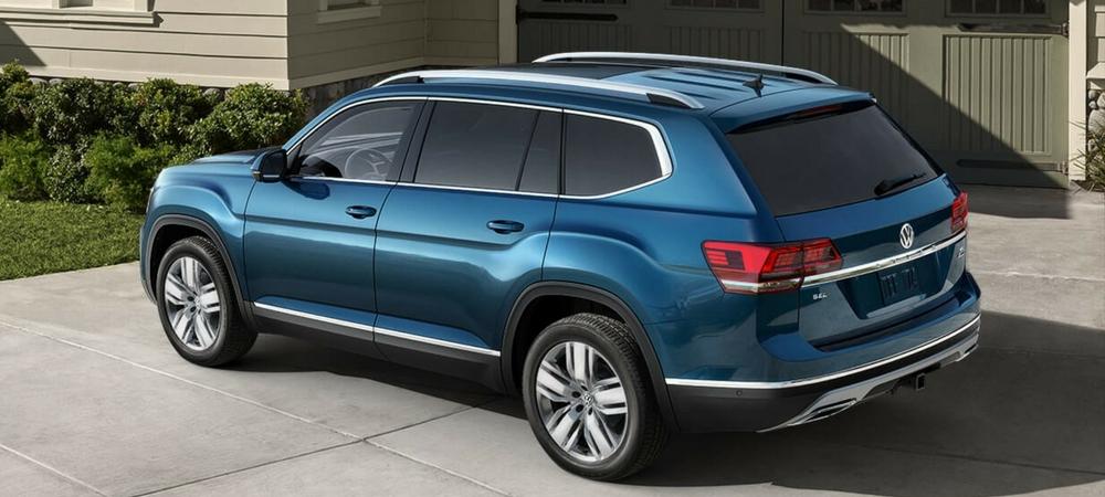 A blue 2018 VW Atlas parked in a driveway