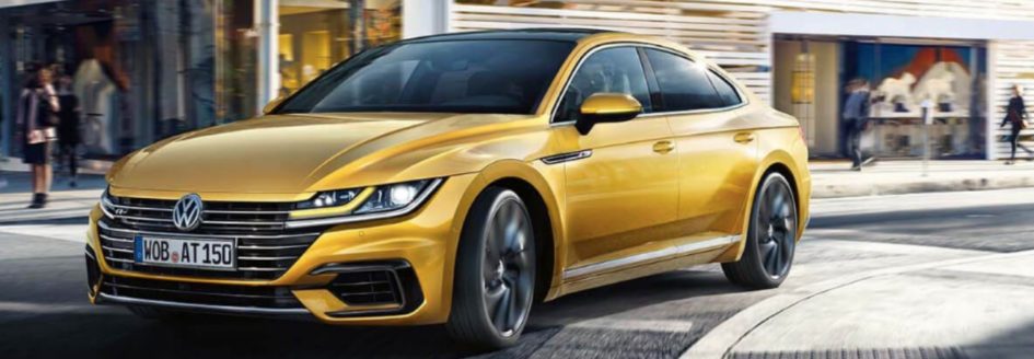 Gold 2019 Volkswagen Arteon turning street corner