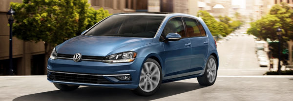 Blue 2019 Volkswagen Golf driving on city streets